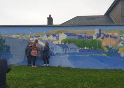 Kids enjoying the mural